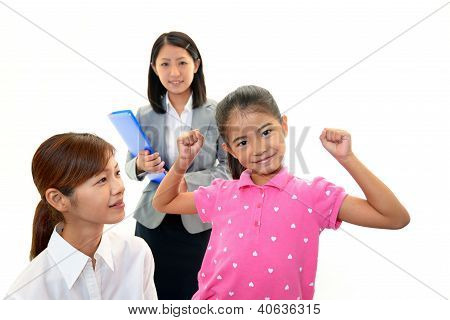 Smiling girl with teacher