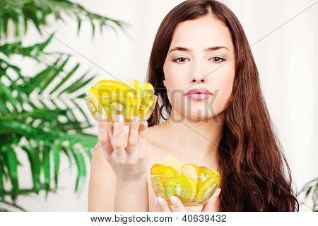 Woman Holding Two Bowl Full Of Fruit
