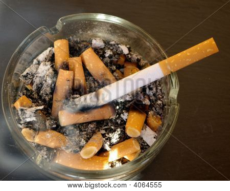 Lighted Cigarette In Ashtray