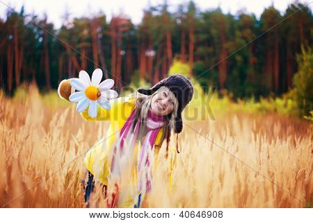 cute girl in cap with ear flaps and flower