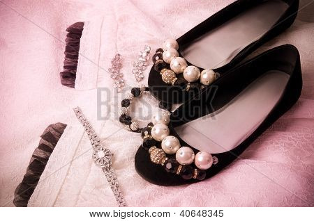 Beautiful accessories and shoes on a white background