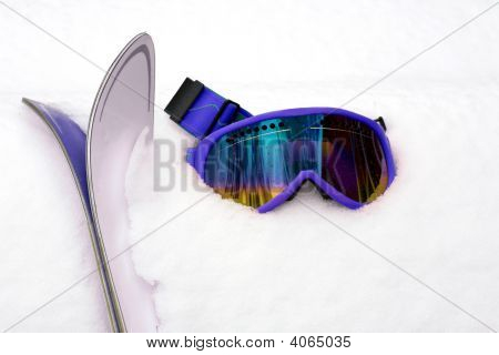 Pink Ski Goggles And Skis