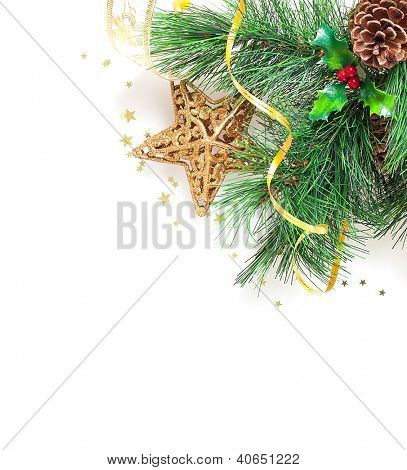 Picture of Christmas tree border, Christmastime greeting card, branch of evergreen tree with star toy and red berry isolated on white background, New Year decoration, xmas ornament