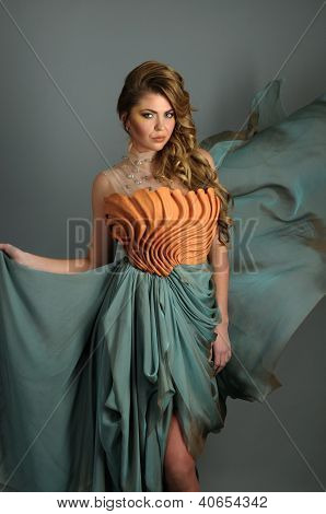 Fashion Model wearing couture designer dress floating in air