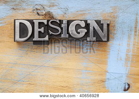 design word in vintage letterpress metal type blocks on wood surface with grunge blue paint