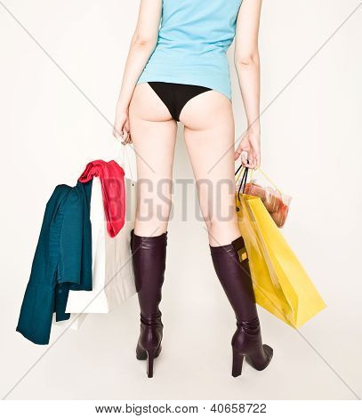 Woman's Back With Shopping Bags
