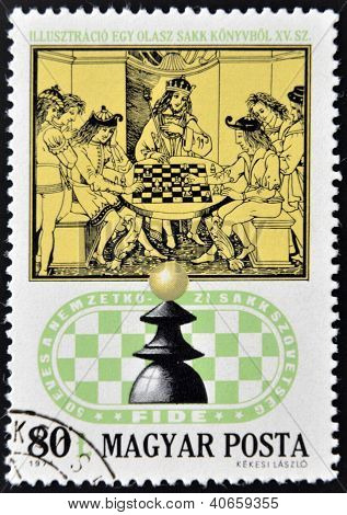 stamp printed in Hungary shows Royal Chess Party from 15th century Italian Chess Book circa 1974