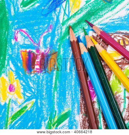 Several Colored Pencils On Children Draw Background