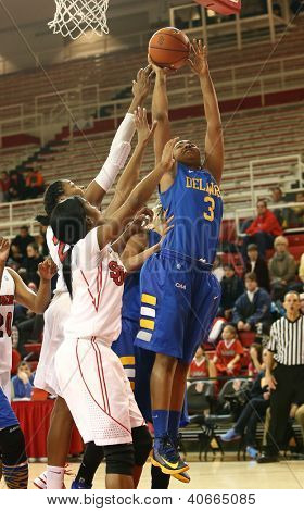 JAMAICA, NY-JAN 2: Delaware Blue Hens guard Jaquetta May (3) goes up for a shot against the St. John's Red Storm at Carnesecca Arena on January 2, 2013 in Jamaica, Queens, New York.