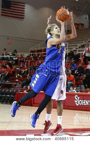 JAMAICA, NY-JAN 2: Delaware Blue Hens guard Elena Delle Donne (11) goes up for a shot against the St. John's Red Storm at Carnesecca Arena on January 2, 2013 in Jamaica, Queens, New York.