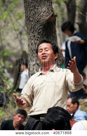Singer at May Day celebration, North Korea