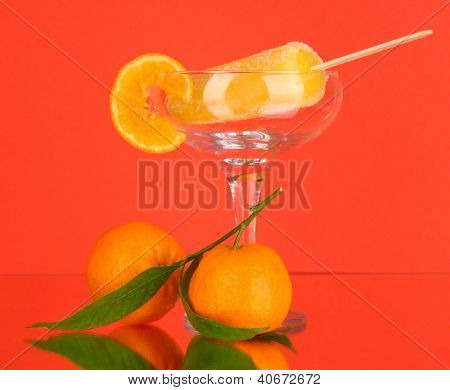 Yellow fruit juice ice in vase on red background