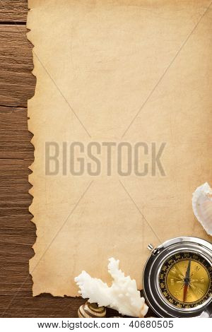 paper vintage background and compass on wood