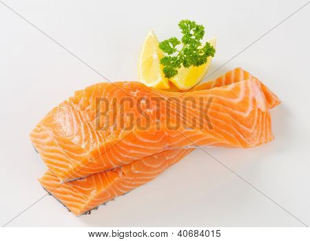 fresh salmon steak with lemon and parsley
