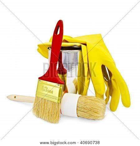 Brushes with yellow gloves and a jar