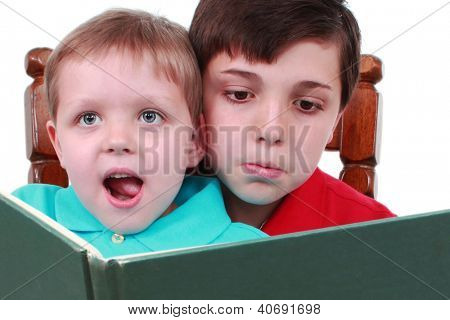 Two boys read a book