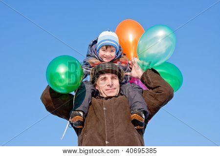 Grand-dad With A Grandchild With Air Marbles