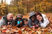 stock photo of biracial  - Happy family with foster children in the forest - JPG
