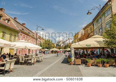 Tourists Relaxing At Street Restaurants