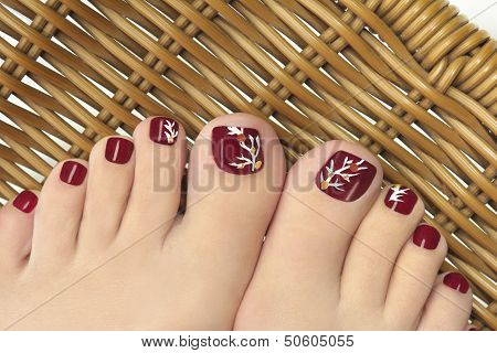 Burgundy pedicure.