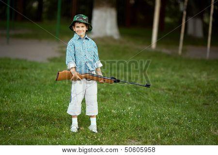 little boy with airgun