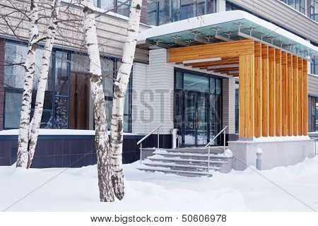 Stoop of modern building decorated with wooden panels