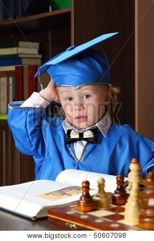 A befuddled boy leafs through a book