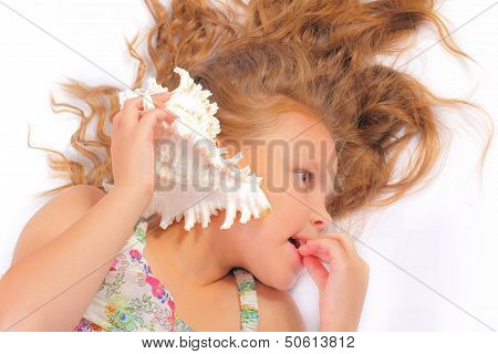 Beautiful Little Girl With Seashell