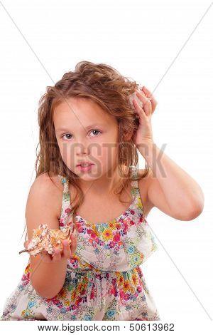 Beautiful Little Girl With Starfish And Seashell