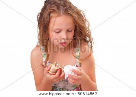 Peaceful Little Girl With Starfish And Seashell