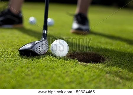 Closeup of hole on golf field