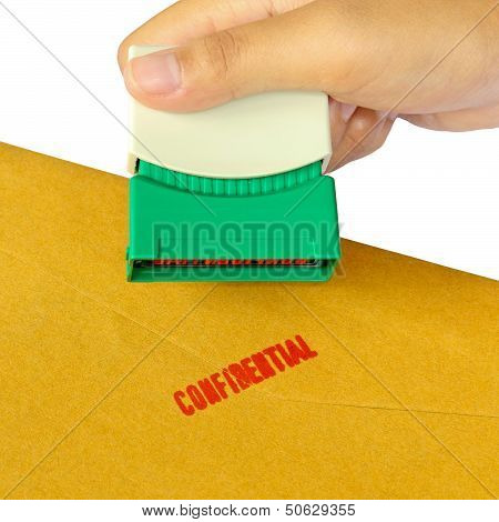 Holding A Confidential Stamper Isolated Over White Background