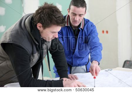 Two construction workers exchanging ideas
