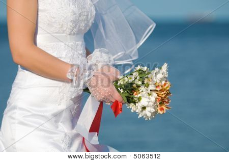 Close-up Of Bride With Flowers
