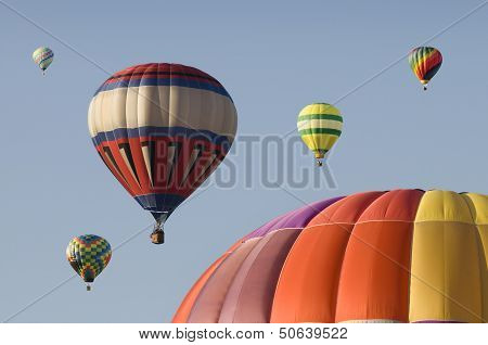 Hot-air Balloons Floating In A Blue Sky