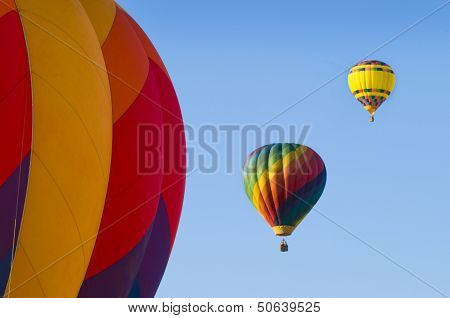 Airborne Hot-air Balloons With One In Foreground