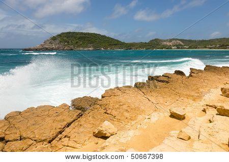 Waves Crashing On Rocky Limestone Coastline At Half Moon Bay