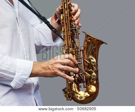 Hands Of A Musician With The Saxophone
