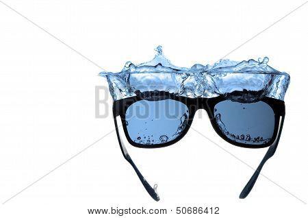 Sunglasses splashing in water isolated on white