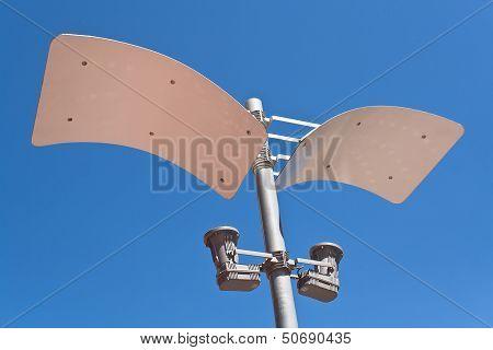 Modern Street Lamp Over Blue Sky