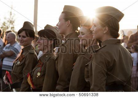 Girls policemen in soldier's uniform of the great Patriotic war in the crowd