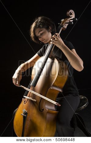 Young musician plays cello