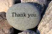 picture of give thanks  - Positive reinforcement word Thank You engrained in a rock - JPG