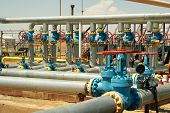 stock photo of inlet  - Industrial valves inlet gas from the wells to the plant for processing - JPG