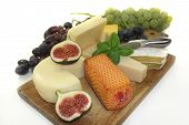 picture of grated radish  - different types of cheese on a wooden board - JPG
