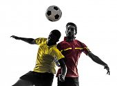 stock photo of struggle  - two men soccer player playing football competition fighting for a ball in silhouette on white background - JPG