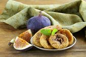 dried figs and fresh fruit on a wooden table
