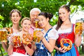 stock photo of lederhosen  - In Beer garden  - JPG