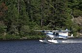 pic of float-plane  - A float plane taking off from a lake in Muskoka Ontario Canada - JPG