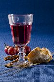 stock photo of communion-cup  - First Holy Communion composition on blue background - JPG